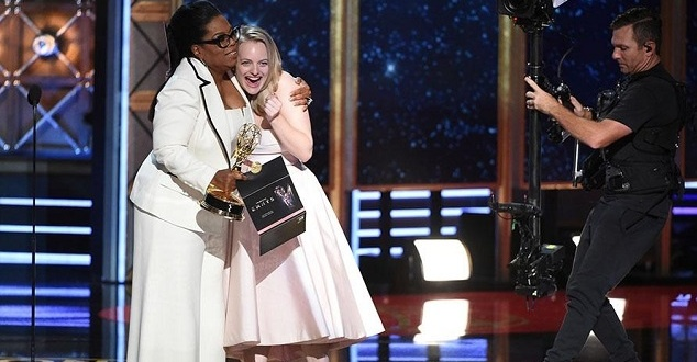 Invision/AP Elisabeth Moss accepts an award at the 2017 Primetime Emmys